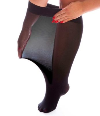 Woman's right leg. Wearing 120 denier plus size black knee highs. Hands stretching top of knee highs.
