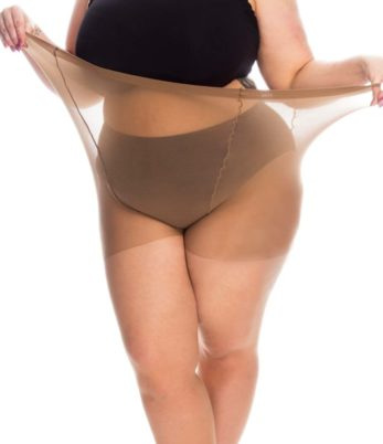 Plus size woman in black bra and knickers wearing plus size 20 denier natural coloured tights