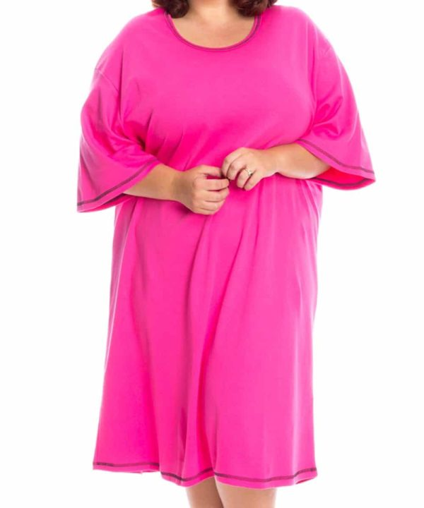 Woman wearing pink plus size lounger. Calf length on leg and below elbow length in arm.