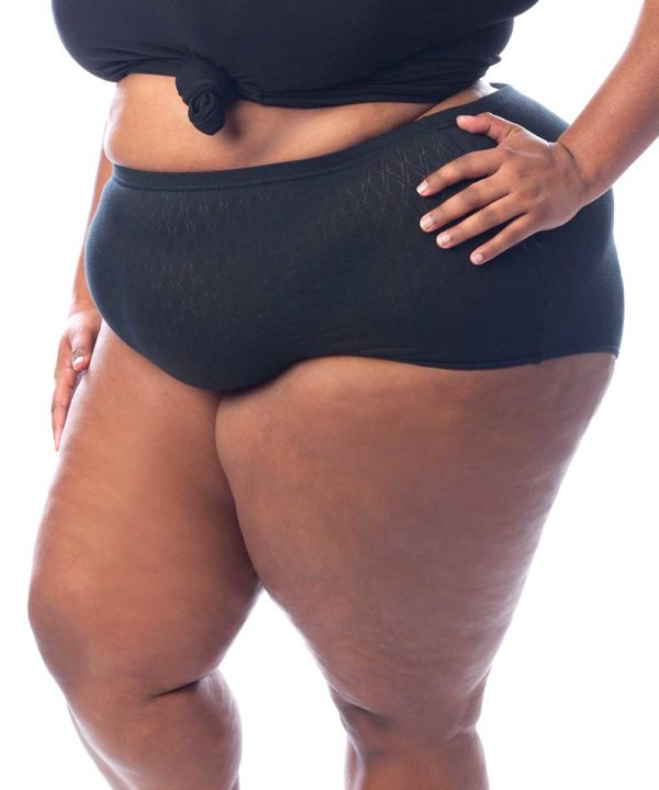 Plus size woman in black cotton t-shirt wearing plus size black plus size airtex lightweight cotton knickers